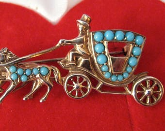 brooch Gold on silver coach with turquoise and Ruby