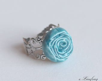 Ring with turquoise flower shaped ceramic, silver plated ring