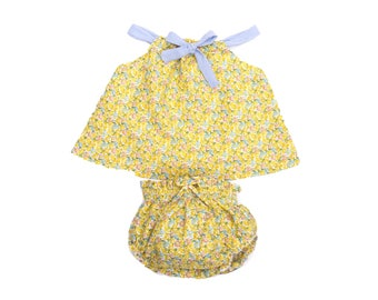 Baby girl was in yellow floral bloomers + blouse and hair clip set