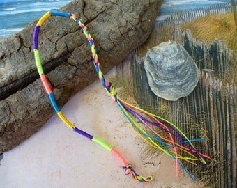 Bracelet braided friendship son multicolored and neon pink and green