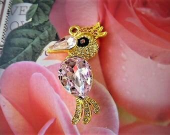 lovely paradise bird pendant size gold tone with large pink Crystal rhinestones