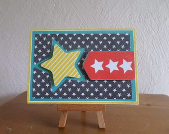 card with a black background with white polka dots and Star