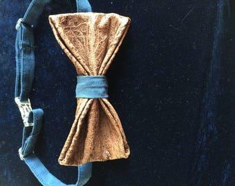 adjustable bow tie looks aged, leather
