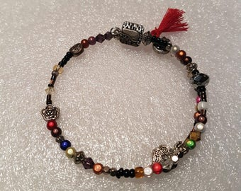 Bracelet shape memory steel with a mixture of crystals