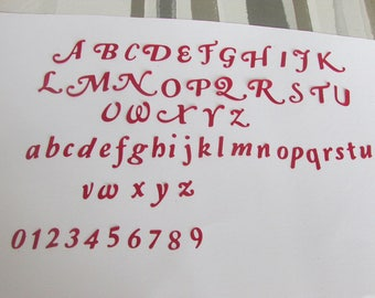 Set of cut red letters of the alphabet and number