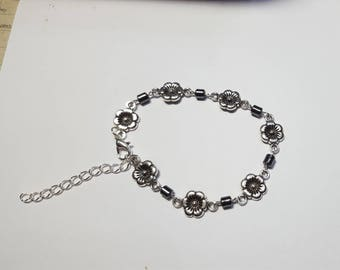 Flower bracelet and hematite beads