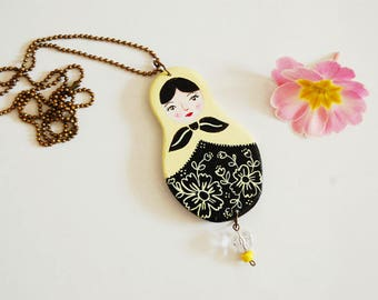 Necklace with matryoshka doll hand painted. Pastel yellow