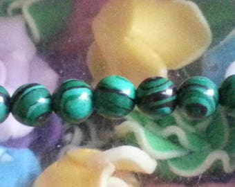 1 Pearl, malachite 6 mm in diameter, hole 1 mm.