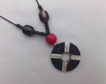 Necklace made of wood inlaid with mother-of-Pearl, big red bead