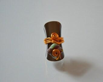 Gold aluminum ring.
