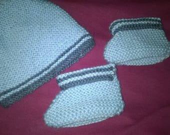 Hand knitted baby booties and hat