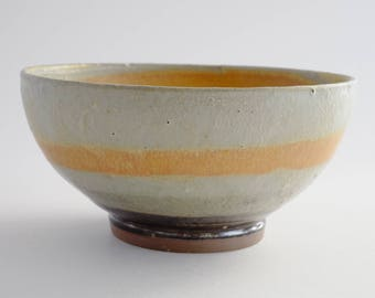 Sunshine gold and parchment white bowl. Handmade, wheel thrown