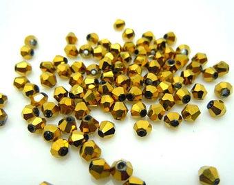 bicone swarovski crystal, gold, 4 mm 20 beads