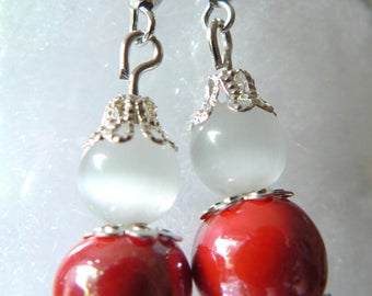 Earrings red and white creamy ceramic beads, and cat's eye