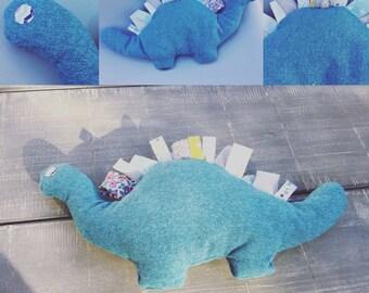 Plush Dino tag all blue fabric.