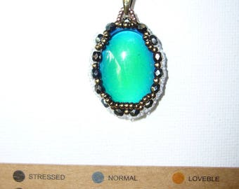 Woven pendant with swarovski faceted gemstone