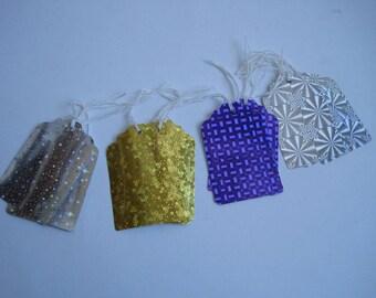 label, paper, shiny, silver, yellow, purple