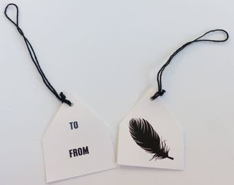 8 tags gift tags To feather... from Pentagon with black string