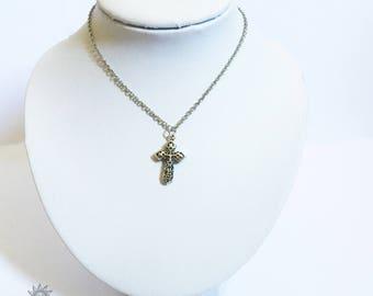 Choker necklace in silver metal nickel with a fancy cross pendant