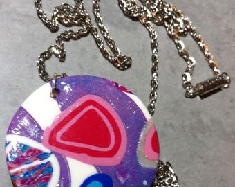 Colorful polymer clay canes in round pendant necklace