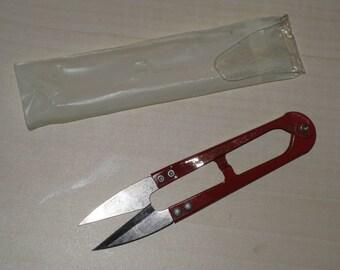 Precision red metal scissors