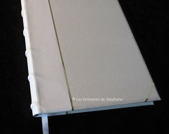 White baby or wedding guest book