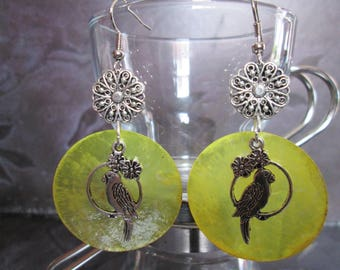 Earrings has large yellow mother of Pearl sequins and birds