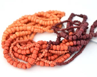 Assortment of orange, red, plum seed beads, size 1.5 mm to 4 mm