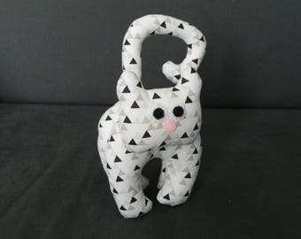white kitten with geometric pattern