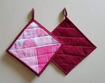 Pink, white, and Red Potholders
