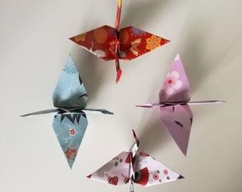 4 handmade origami cranes