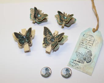 assortment of embellishments clips made of wood and blue butterfly theme paper tag/label