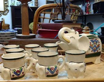 Elephant tea pot with with elephant tea cups