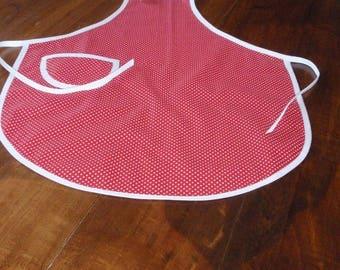 Kids apron has red bib has white polka dots