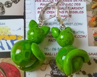 Earrings polymer clay mosaic cats in shades of green.