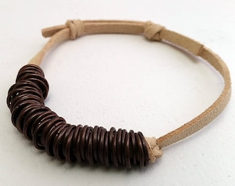 Bronze rings and leather bracelet