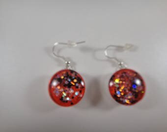 Earrings with clip is handmade glass cabochons and therefore unique