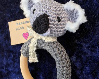Sweet crochet Rattle/Teether with koala bear with lint-ears and lace scarf.