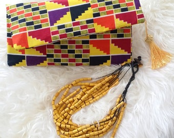 Trendsetter Fabric Clutch With Tassel