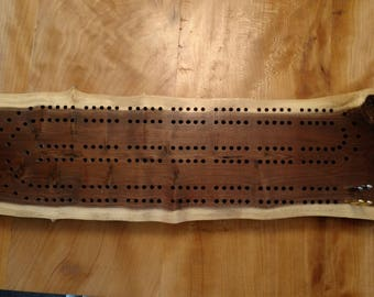 This is a beautiful hand made cribbage board