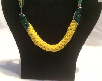 Choker necklace in yellow and green t-shirt