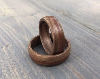 His and hers walnut wood rings  // bentwood rings made of walnt with red shale inlay