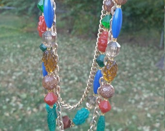 Gold colored chains and multi colored beads necklace