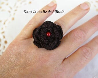 Black crochet flower ring and red glass beads