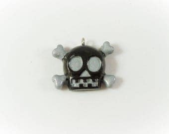 Black and silver skull charm
