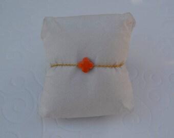 Orange clover bracelet on gold chain
