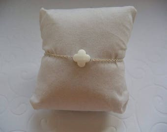 Opaque white clover bracelet on silver chain.
