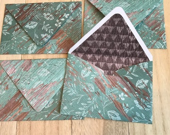 Teal wood grain lined envelopes with notecards
