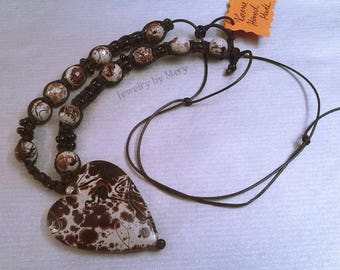 Necklace with big painted heart, beads in natural colors and macrame with a small black beads
