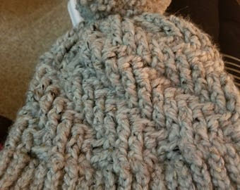 Stepping texture hat with a pom pom